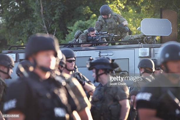 Police take up position to control demonstrators who were protesting the killing of teenager Michael Brown on August 12, 2014 in Ferguson, Missouri....