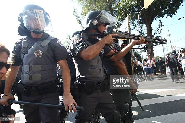 Police take up positions during a World Cup protest outside Carrao Metro Station on June 12 2014 in Sao Paulo Brazil Military police responded to the...