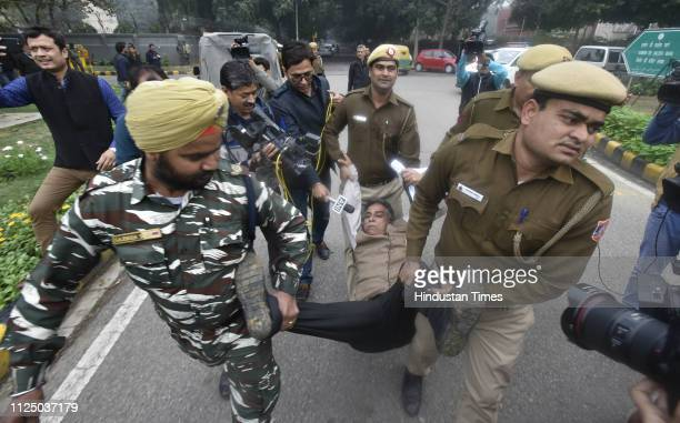 Police takes away members of National Panther Party of Jammu and Kashmir during a protest against Thursday's Pulwama terror attack outside Pakistan...