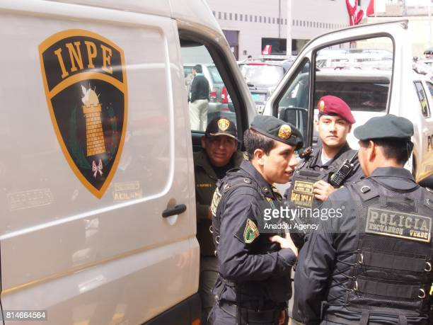 Police takes security measures during the transportation of former Peruvian President Ollanta Humala while and his wife Nadine Heredia toward the...