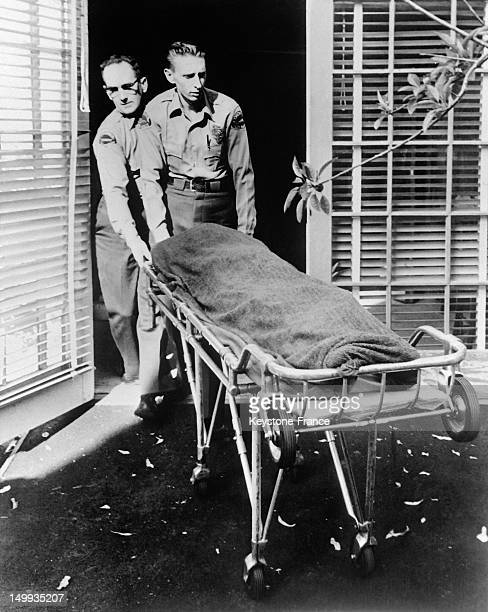Police taking away the remains of American actress Marilyn Monroe found dead at home on August 5 1962 in Los Angeles United States