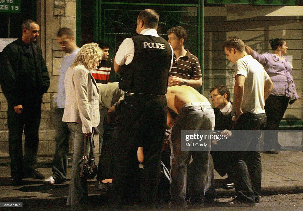 Police talk to a man after being assaulted outside a nightclub in Bath on October 15, 2005 in Bath, England. Pubs and clubs preparing for the new Licensing laws due to come into force on November 24 2005, which will allow pubs and clubs longer and more flexible opening hours.Opponents of the law believe this will lead to more binge-drinking with increased alcohol related crime, violence and disorder while health experts fear an increase in alcohol related illnesses and alcoholism.