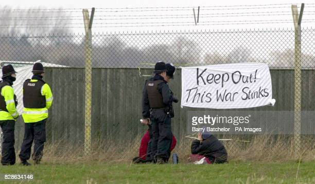 Police talk to anti-war protestors at the perimeter fence of the US airbase at RAF Fairford, Gloucestershire. Twelve people were today arrested at...