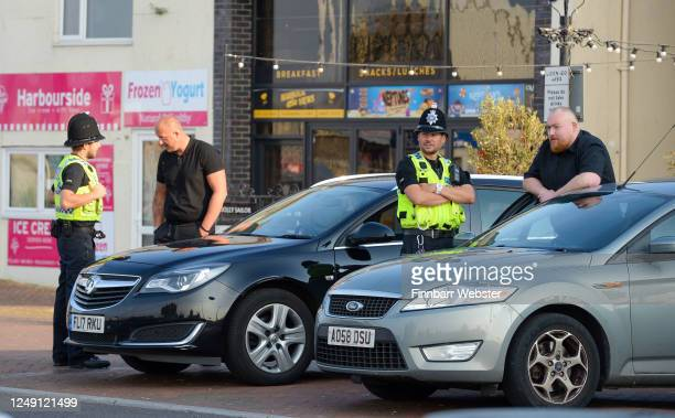 Police talk to security at the Lord Baden-Powell statue on June 12, 2020 in Poole, United Kingdom. The statue of Robert Baden-Powell on Poole Quay is...
