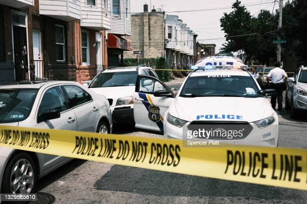 Police tape blocks a street where a person was recently shot in a drug related event in Kensington on July 19, 2021 in Philadelphia, Pennsylvania....