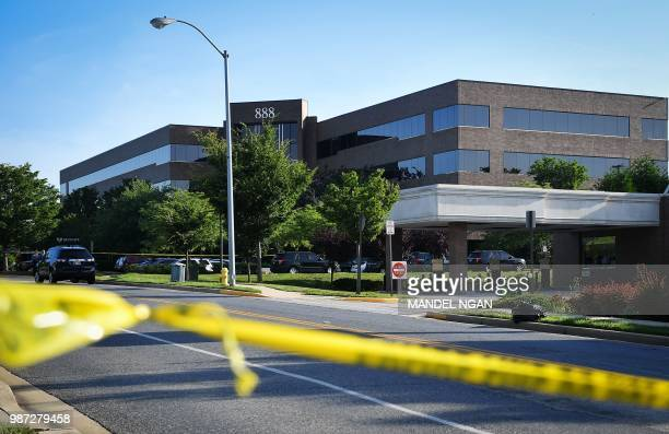 Police tape blocks access from a street leading to the building complex where The Capital Gazette is located on June 29 in Annapolis Maryland Jarrod...
