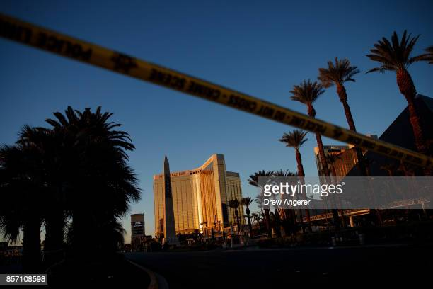 Police tape blocks off part of Las Vegas Blvd near the scene of Sunday night's mass shooting at a concert near Mandalay Bay Resort and Casino October...