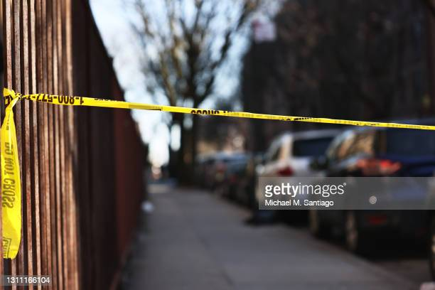 Police tape blocks off the scene of a shooting that left multiple people injured in the Flatbush neighborhood of the Brooklyn borough on April 06,...