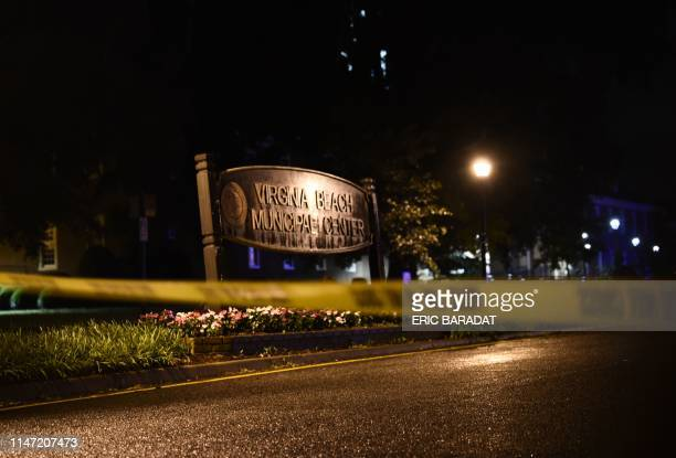 A police tape blocks the road to access the Virginia Beach municipal center the site of a mass shooting in Virginia Beach Virginia in the late hours...