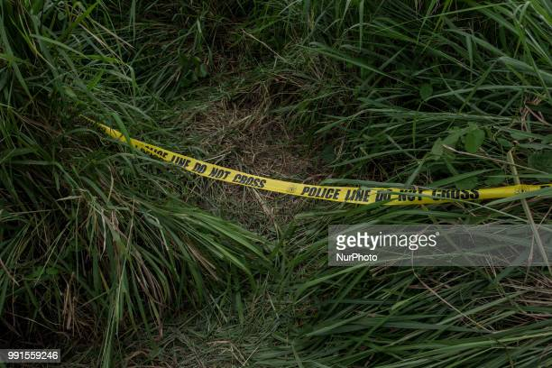 Police tape cordons of the area presumably where a suspected gunman positioned and assassinated Tanauan Mayor Antonio Halili who was taking part in a...
