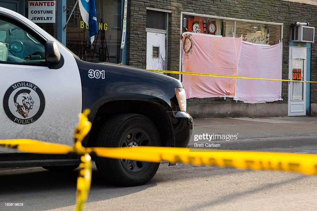 Police tape cordons off the area around John's Barber Shop after a gunman opened fire inside on March 13, 2013 in Mohawk, New York. Police have identified 64-year-old Kurt Meyers as a possible suspect responsible for a total of four shooting deaths and two injuries across the area earlier in the day.
