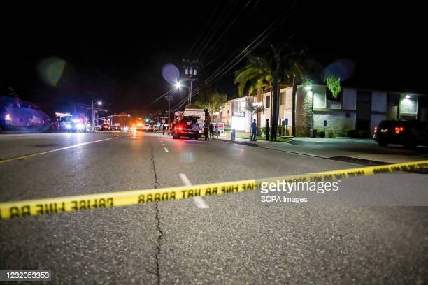 Police tape cordons off the building where the shooting occurred. On Wednesday evening, four people, including a child, were killed in an office...