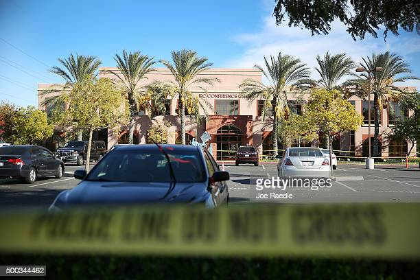 Police tape hangs in front of the builiding at the Inland Regional Center were 14 people were killed on December 7, 2015 in San Bernardino,...