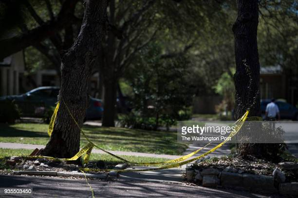 Police tape hangs in the neighborhood where the fourth bomb went off in Austin Texas on March 20 2018