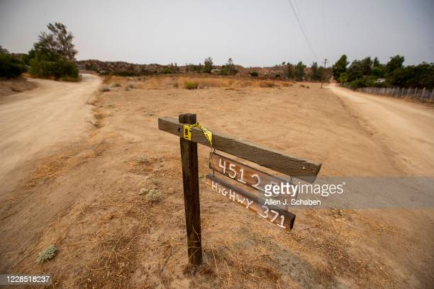 Police tape hangs on a sign at the location where seven people were shot to death over Labor Day weekend at an illegal marijuana grow house in the...