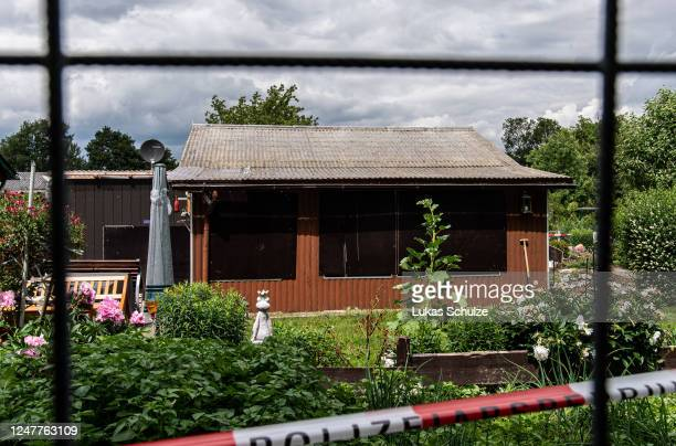 Police tape hangs outside a garden colony house following the arrest of 11 people in a pedophile case on June 07, 2020 in Muenster, Germany....