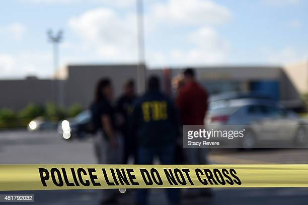 Police tape hangs outside of the Grand Theatre on July 24 2015 in Lafayette Louisiana Two People were killed and nine others wounded when a shooter...