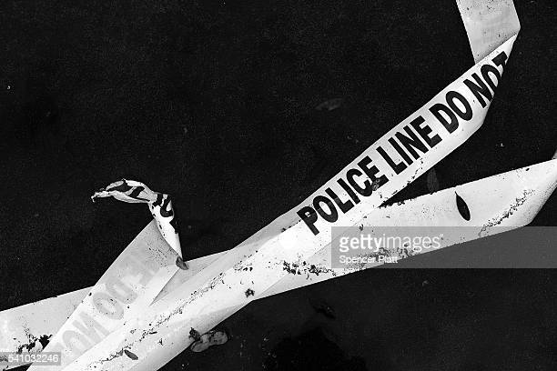 Police tape is discarded on the ground near the Pulse nightclub in downtown Orlando on June 17 2016 in Orlando Florida Following a week of sucessive...