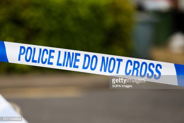 Police tape is seen at a crime scene in London.