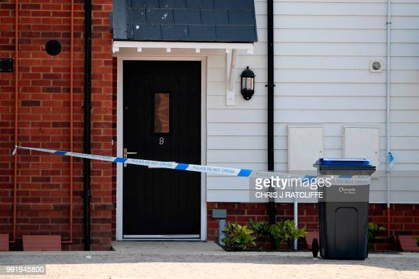 Police tape is seen cordoning off the front door of a residential address in Amesbury southern England on July 5 2018 where police reported a man and...