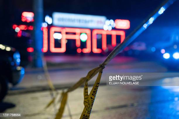 Police tape is seen outside a massage parlor where a person was shot and killed on March 16 in Atlanta, Georgia. - Eight people were killed in...