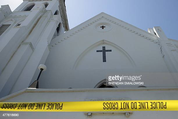 Police tape is seen outside the Emanuel AME Church after a mass shooting at the Emanuel AME Church the night before in Charleston South Carolina on...