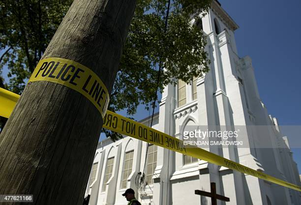 Police tape is seen outside the Emanuel AME Church, after a mass shooting at the Emanuel AME Church the night before in Charleston, South Carolina on...