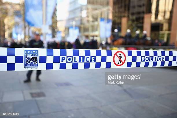 Police tape is seen to control protester movements as 'Reclaim Australia' protesters and counter protesters gather on July 19 2015 in Sydney...