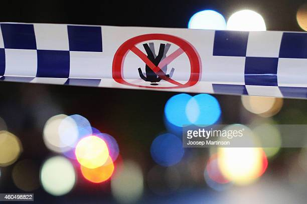 Police tape is streched near the Lindt Chocolate Cafe in Martin Place following a hostage standoff on December 16 2014 in Sydney Australia Two were...