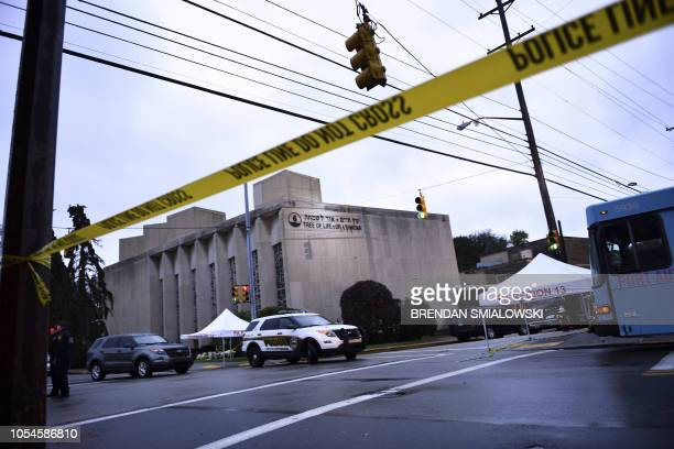 TOPSHOT Police tape is viewed around the area on October 28 2018 outside the Tree of Life Synagogue after a shooting there left 11 people dead in the...