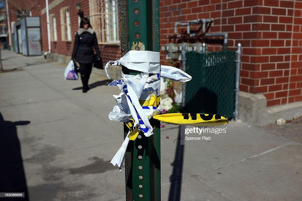 Police tape is viewed near where a Brooklyn Orthodox couple and their unborn child were killed in a hit and run crash in the Brooklyn borough on March 4, 2013 in New York City. The couple, Nachman and Raizy Glauber, were on the way to the hospital to deliver their baby early Sunday morning when the livery cab they were in was hit by a BMW going at a high rate of speed. Doctors managed to temporarily save the Glauber's baby boy through a cesarean section, but the 21 year-old couple died early Sunday. The baby died shortly after on Monday at Bellevue Hospital. New York City police are searching for the driver and a passenger of the BMW who left the scene of the accident..