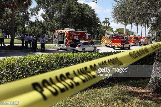 Police tape keeps people back as the The Broward Sheriff's Office bomb squad deploys a robotic vehicle to investigate a suspicious package in the...