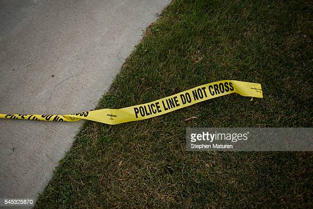 Police tape left Larpenteur Avenue following the police shooting death of a black man on July 7 2016 in St Paul Minnesota Philando Castile was shot...