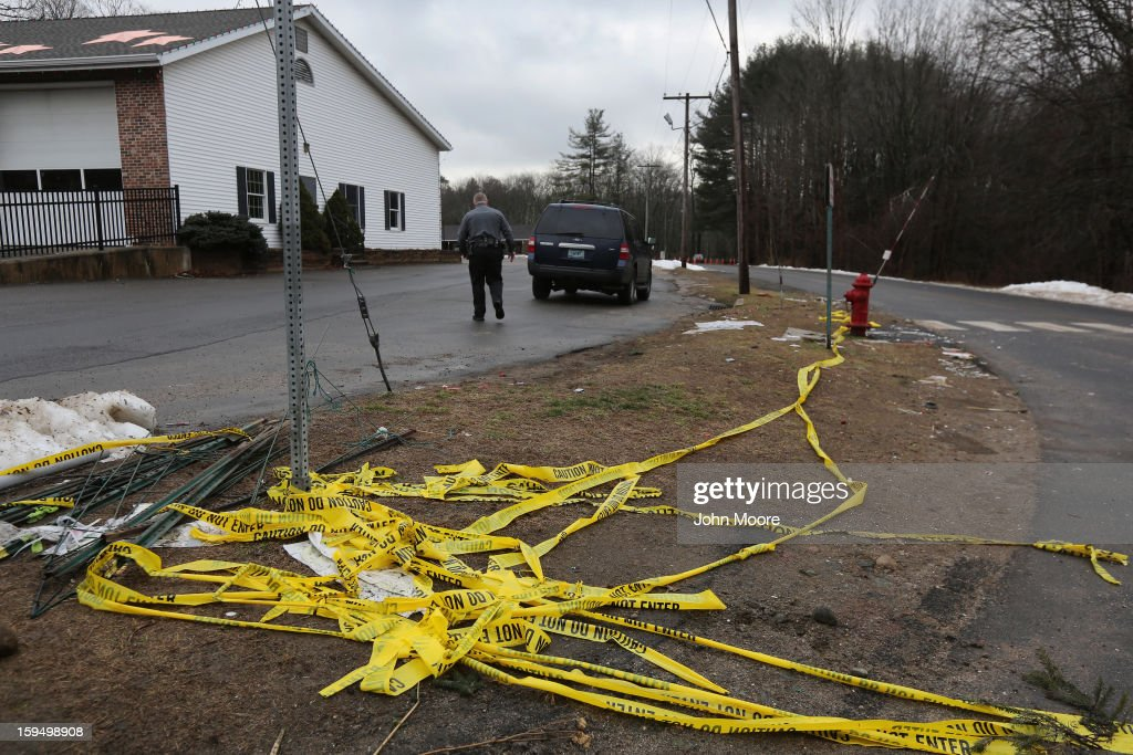Police tape lies bunched near the road to Sandy Hook Elementary School on January 14, 2013 in Newtown, Connecticut. The town marked a month anniversay since the massacre of 26 children and adults at the school, the second-worst such shooting in U.S. history.