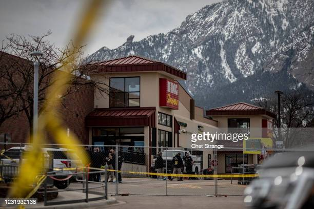 Police tape lines the site of a shooting at a King Soopers grocery store on March 25, 2021 in Boulder, Colorado. The Monday shooting left 10 people...