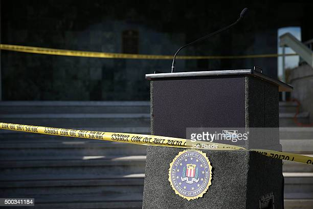 Police tape marks off the podium as the media waits for the arrival of David Bowdich, FBI Assistant Director in Charge of the Los Angeles Field...