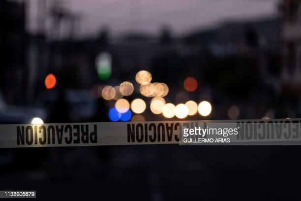 A police tape marks the perimeter of a crime scene where a man was killed by gun fire in downtown Tijuana Baja California state Mexico on April 21...