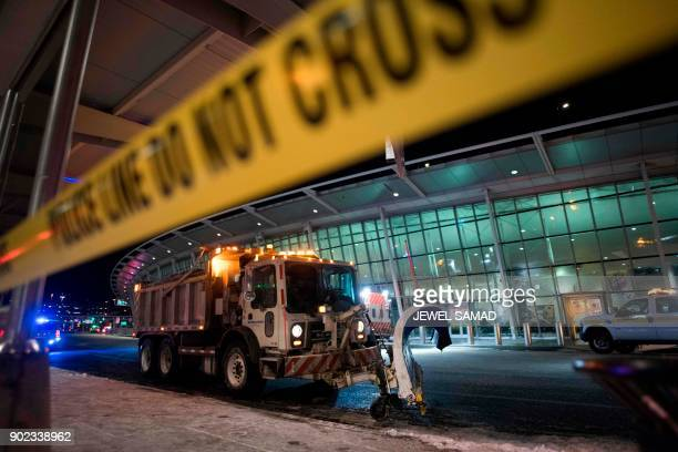 Police tape off an area of the John F Kennedy International airport's terminal 4 following a water main break in New York on January 7 2018...