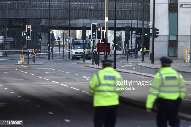 Police tape off Lower Thames Street following yesterday's London Bridge stabbing attack as investigations continue on November 30 2019 in London...