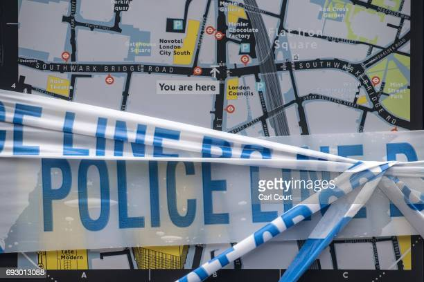 Police tape partly covers a tourist direction sign near London Bridge following Saturday's terrorist attack on June 6 2017 in London England The...