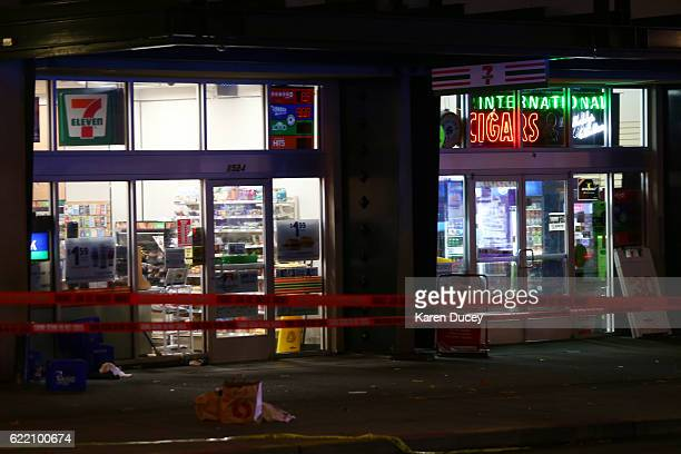 Police tape ropes off the sidewalk outside a 7Eleven near Pine Street and 3rd Avenue after five people were shot and wounded on November 9 2016 in...