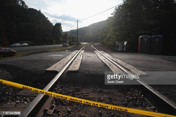 Police tape runs across the railroad tracks that lead to one of Blackjewel's coal mines where unemployed Blackjewel Coal miners have formed a...