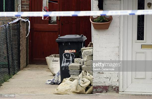 Police tape seals off number 41 Micklefield Road following a police raid on August 10, 2006 in High Wycombe, England. Police were today searching...