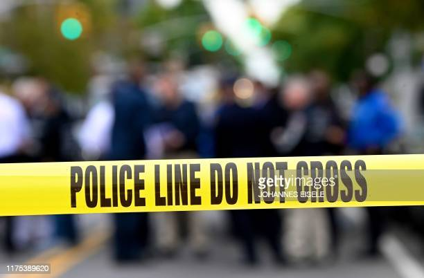 Police tape secures a crime scene outside a club after a shooting in Brooklyn on October 12 2019 At least four people died and three were wounded in...
