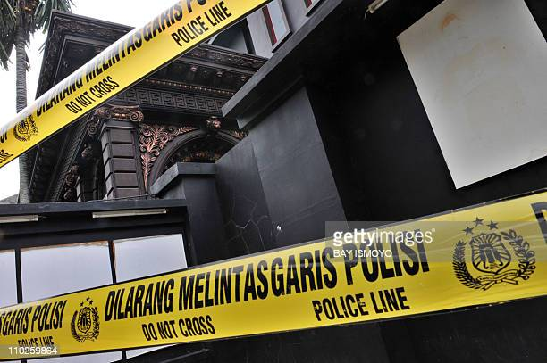 Police tape secures the residence of Indonesian rock musician Ahmad Dhani who is known for his songs protesting against religious extremism in...