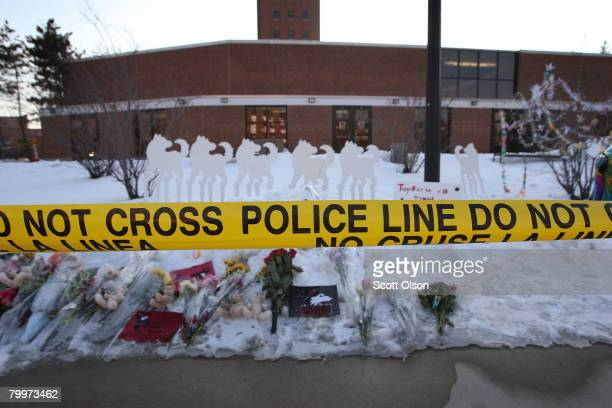 Police tape still circles Cole Hall on the campus of Northern Illinois University students February 24 2008 in DeKalb Illinois Six people were killed...