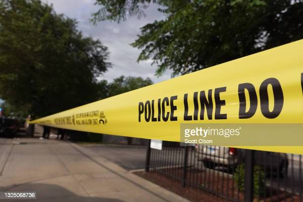 Police tape surrounds a crime scene where three people were shot at the Wentworth Gardens housing complex in the Bridgeport neighborhood on June 23,...