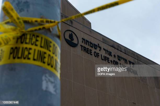 Police tape wrapped around a traffic light pole out front of the Tree of Life Synagogue in Squirrel Hill outside of Pittsburgh Members of Pittsburgh...