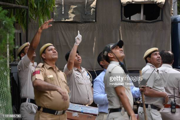 Police team inspects the house where an elderly couple along with their domestic help were found murdered, at Vasant Apartments, in Vasant Vihar on...