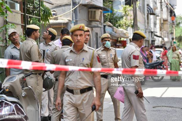 Police team investigates the house where an elderly couple along with their domestic help were found murdered, at Vasant Apartments, in Vasant Vihar...